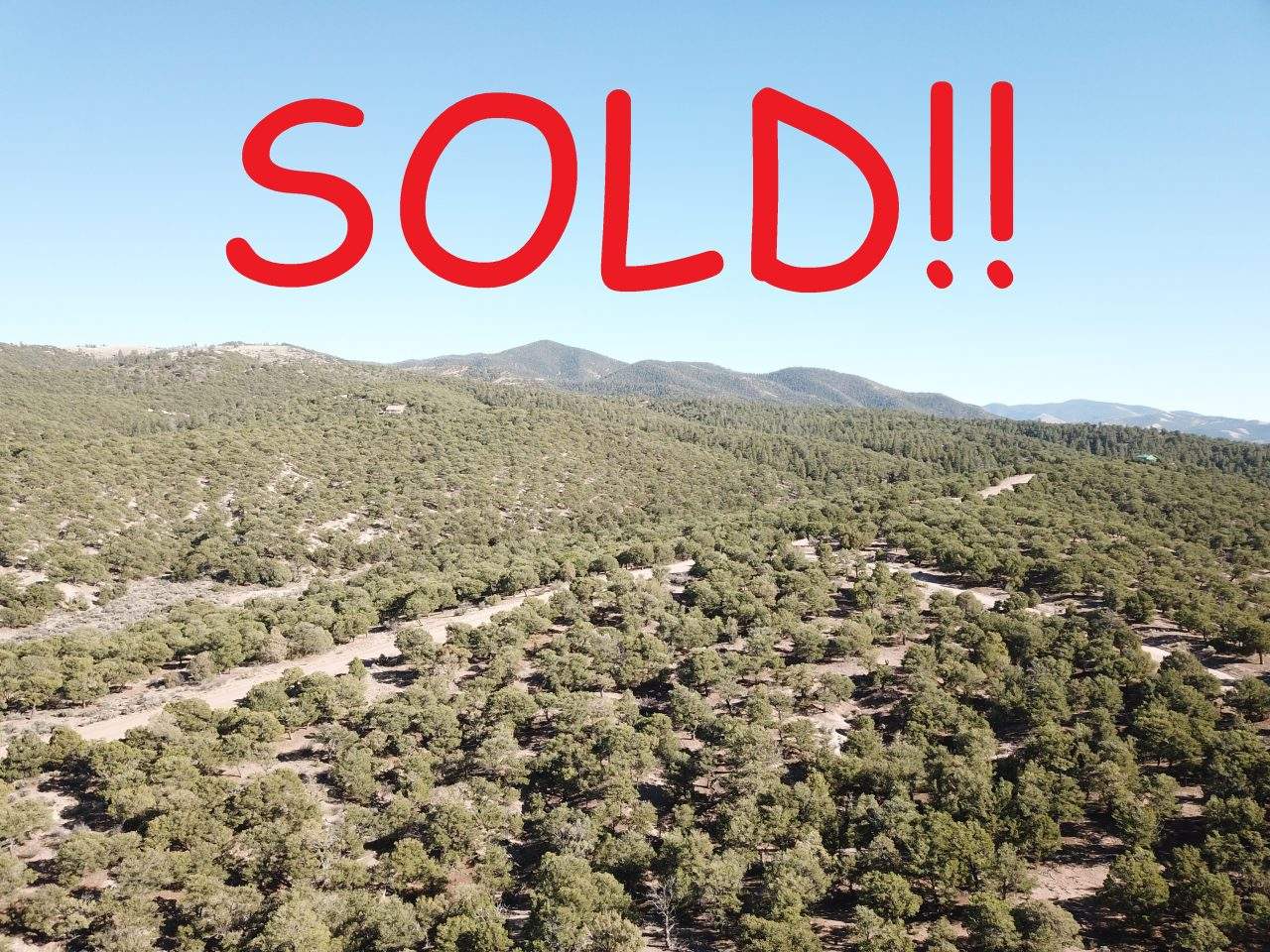 SOLD!! 10+ Mountain Acres. Endless Views!